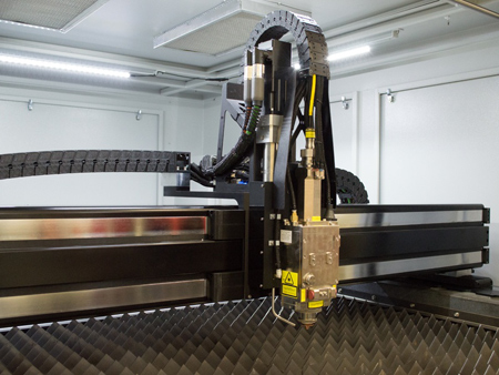 Flatbed laser cutting head