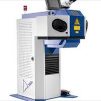 Laser welding system with a closed working chamber